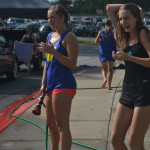 Sophomores Hannah Phillips and Miranda Hack laugh as their peers spray each other with the hose. Photo by Morgan Plunkett