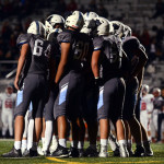 East offense huddles before a play. Photo by Audrey Kesler