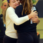 Junior Ally Huffman hugs senior Claire Pottenger on Senior Night. Photo by Audrey Kesler