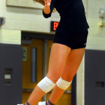 Junior Sydney Ashner serves the ball to the opposing team. Photo by Audrey Kesler