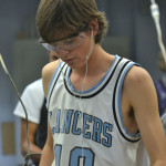 Sophomore Abe Laughlin sands his cutting board, and gets it ready to be finished. Photo by Morgan