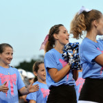 Junior Chloe Kolwaski cheers with the little lancer cheerleaders on the sidlelines of the football game. Photo by Katherine Odell