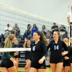 Seniors Emma Henderson and Sara Maddox high five the players from the opposing team, DeSoto. Photo by Katherine Odell