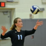 Junior Victoria Yedo serves the ball to get the dual started. Photo by Katherine Odell