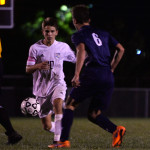Senior Oliver Bihuniak approaches a Mill Valley player to take back the ball. Photo by Kaitlyn Stratman