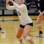 Junior Ally Huffman prepares to set the ball. Photo by Ellen Swanson