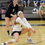 Junior Ally Huffman gets low in preparation to bump the ball. Photo by Ellen Swanson