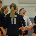 Junior Ally Huffman celebrates with her teammates after scoring a point. Photo by Libby Wilson