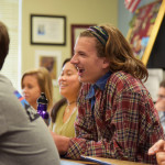 Sophomore Seth Arveson laughs at leader Peter McDonald's funny comments throughout the meeting. Photo by Ava Simonsen