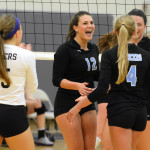 Senior Claire Pottenger cheers with her teammates after winning a point. Photo by Ellie Thoma