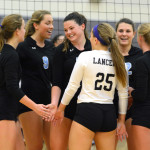 Senior Emma Henderson is congratulated after winning a point for the team. Photo by Ellie Thoma