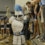 The Lancer mascot kneels in front of the bleachers and rouses the crowd during a free throw attempt. Photo by Allison Stockwell