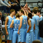 The team huddles up during a timeout. Photo by Luke Hoffman