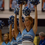The Varsity cheerleaders hold their poms up while East shoots free-throws. Photo by Katherine Odell