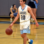 Junior Will Curran dribbles down the court during the last possession of the first half. Photo by Laini Reynolds