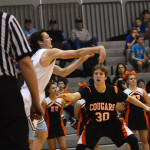 Senior Connor Rieg passes the ball in after a foul. Photo by Ty Browning