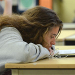 Junior Sophie Smith rests her head on the table, as she listens to her graphic design teacher giving instructions. Photo by Morgan Plunkett