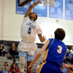 Junior Kelyn Bolton dunks the ball in the 3rd quarter of the game. Photo by Maddie Smiley