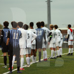 Both teams lines up at the top of the 18 yard box awaiting a free kick. Photo by Bella Wolfe