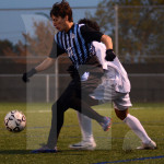 Senior Byers Waldo gets in front of his defender to gain possession of the ball. Photo by Elise Madden
